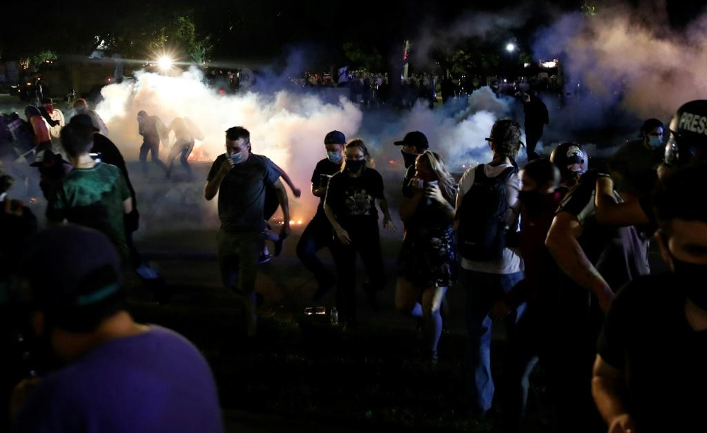 Police in the Wisconsin city of Kenosha used tear gas on August 25, 2020 in a bid to break up a demonstration sparked by the police shooting of Jacob Blake, a black man, as his three children watched