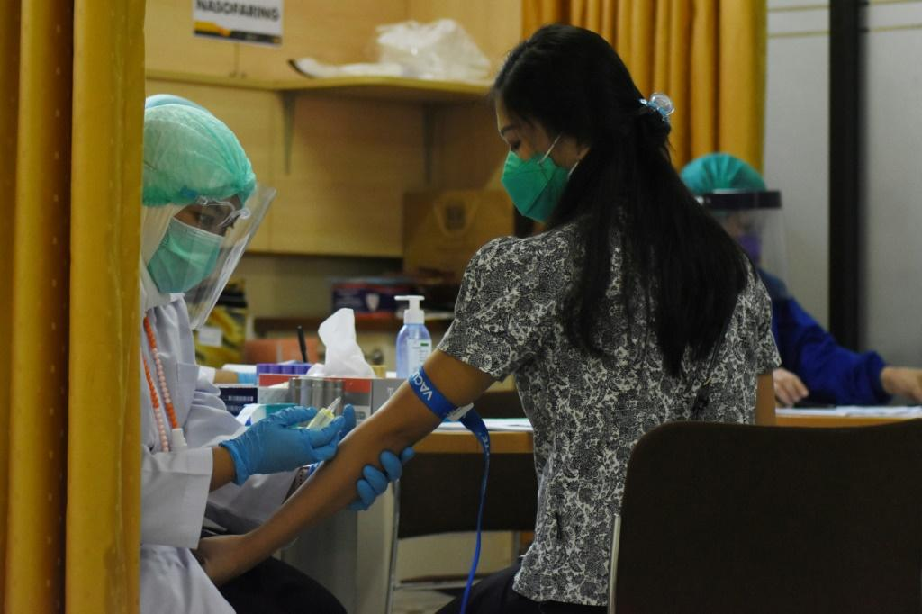 Potential vaccines are being tested on volunteers in a number of countries worldwide, including Indonesia