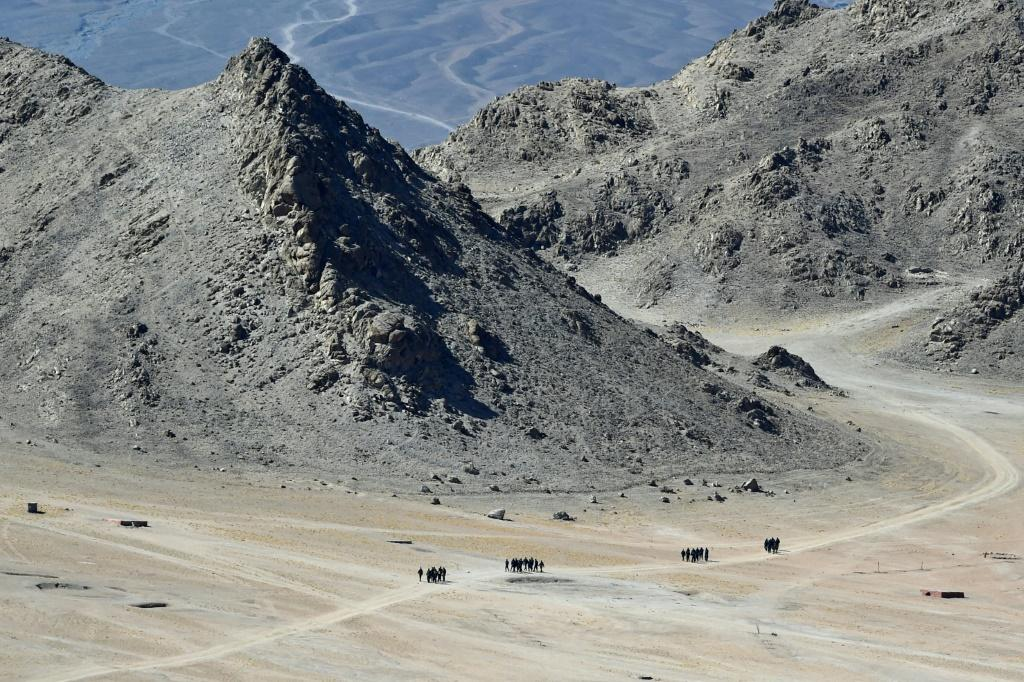Indian soldiers walk in the foothills of a mountain range near Leh in Ladakh on June 23, 2020. Chinese and Indian troops have had a number of showdowns since a deadly clash on June 15