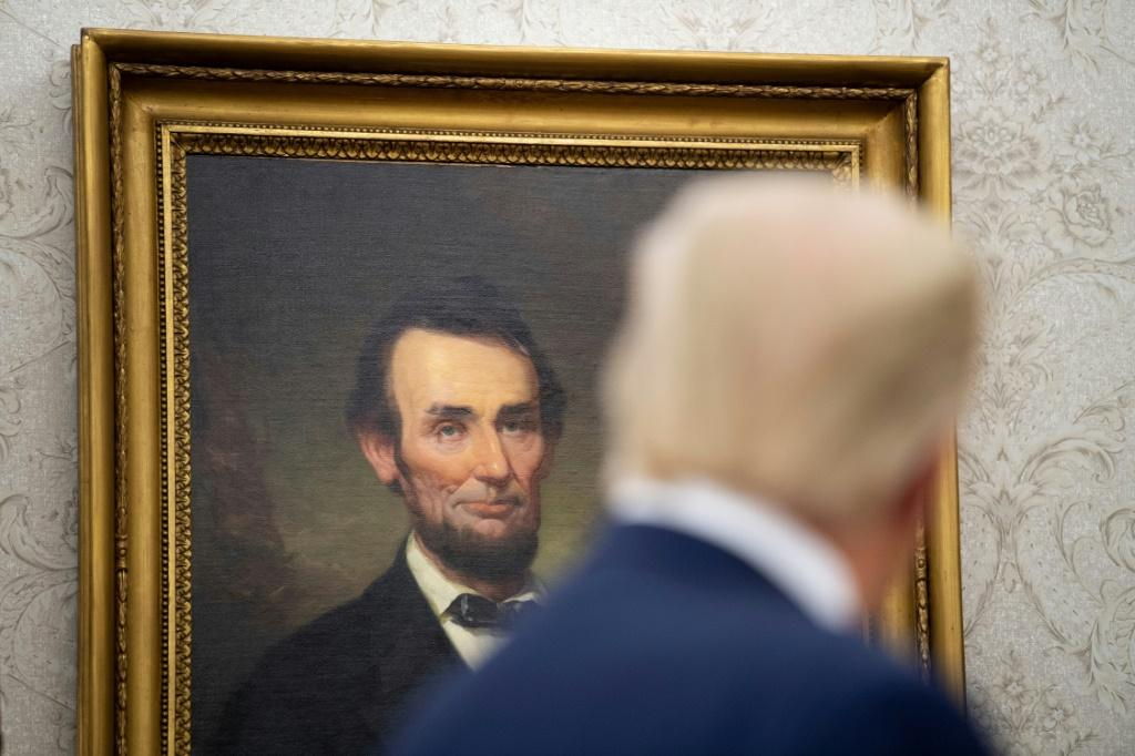 President Donald Trump looks at a portrait of Abraham Lincoln in the White House in August 2020