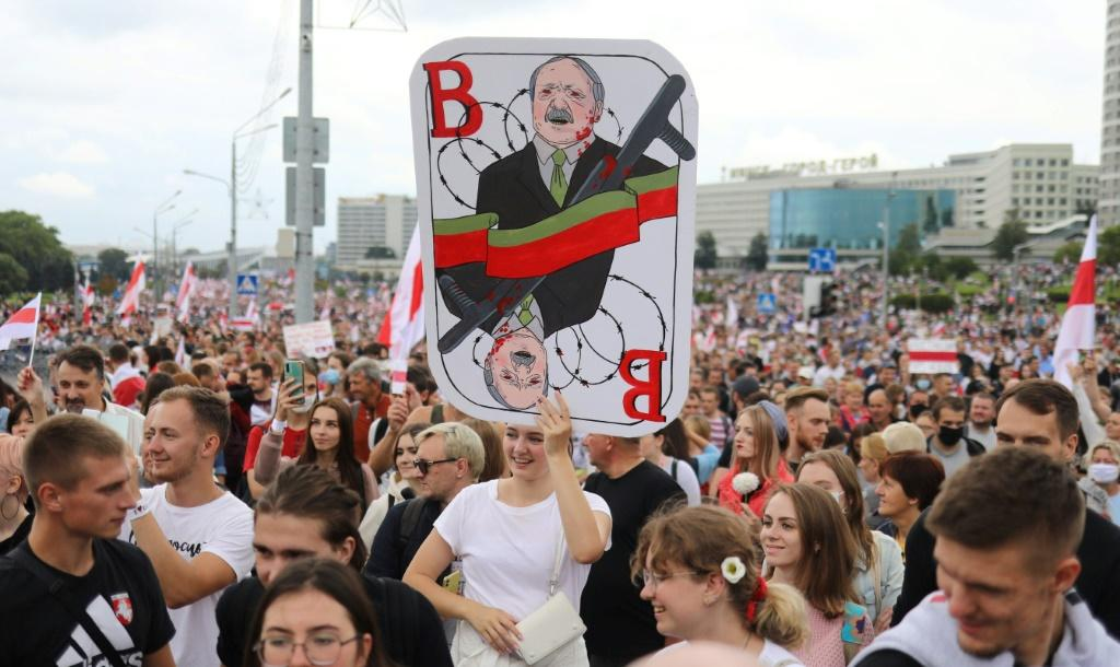 Many protesters held red-and-white flags and placards while a band beat drums and played other instruments