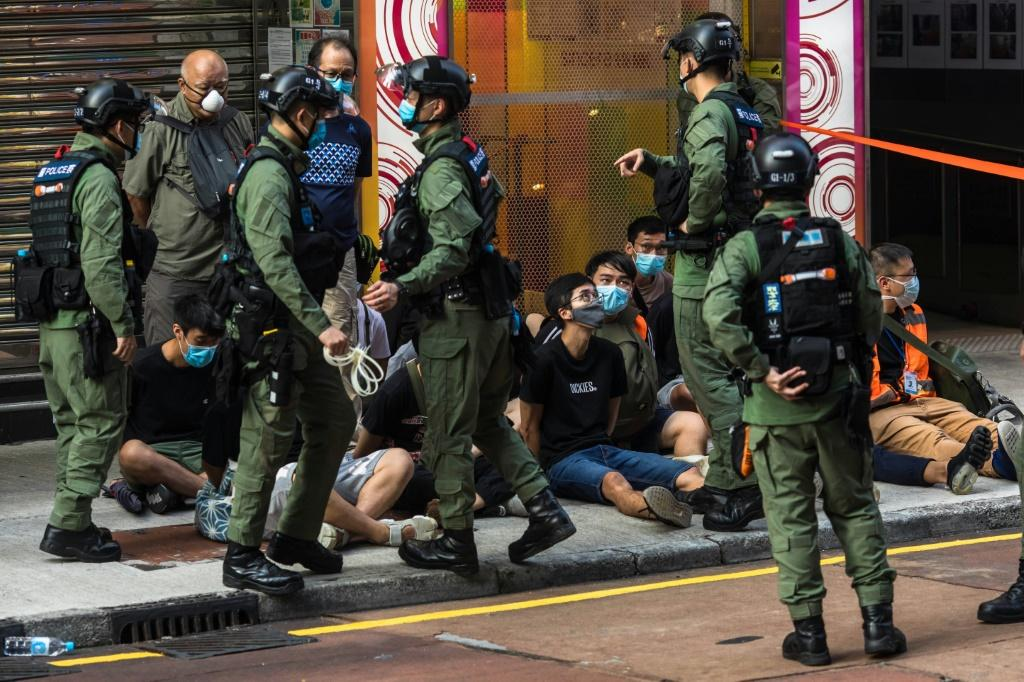 Police arrested nearly 100 people in Hong Kong who were protesting against the cancellation of local elections