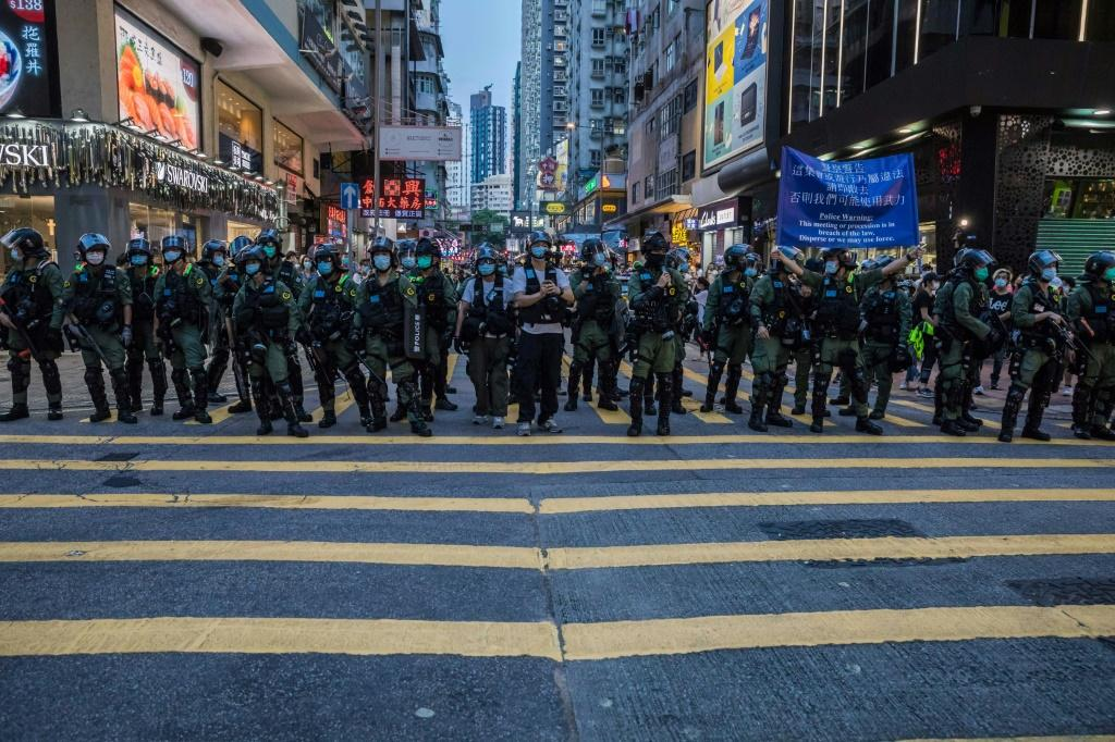 Police patrol after protesters rallied in Hong Kong to protest against the government's decision to postpone the legislative council elections