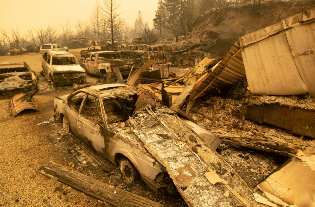 Burned vehicles smoldering in the Creek Fire in Fresno County, California