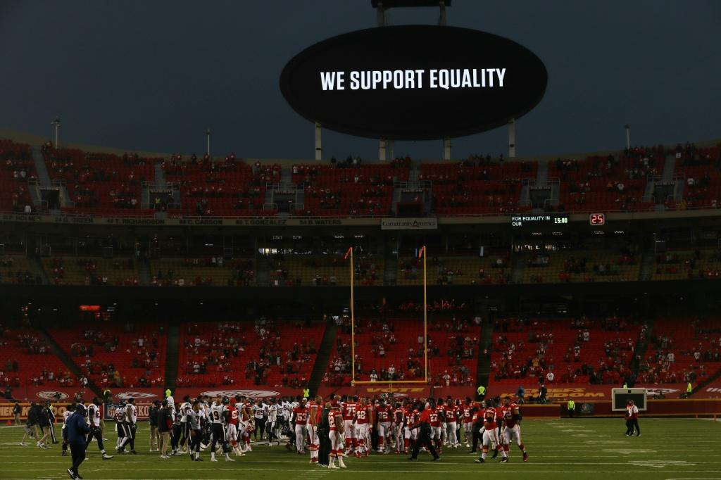 Kansas City Chiefs and Houston Texans players line up for a moment of unity ahead of their season-opening NFL game