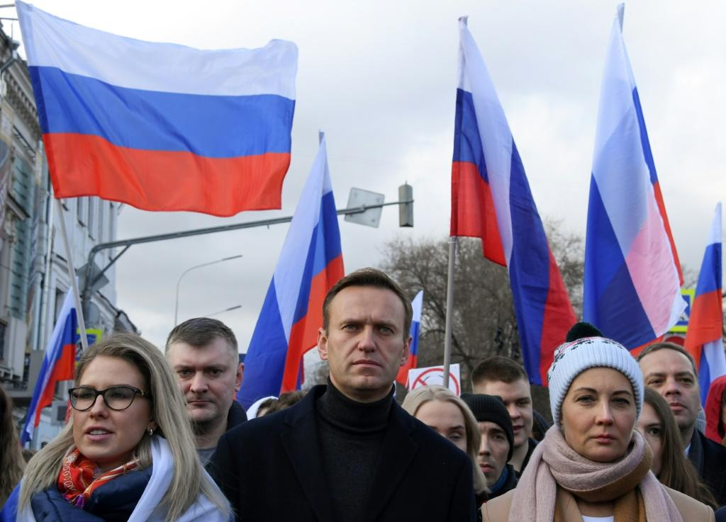 Alexei Navalny (C) had been campaigning for tactical voting before he was poisoned