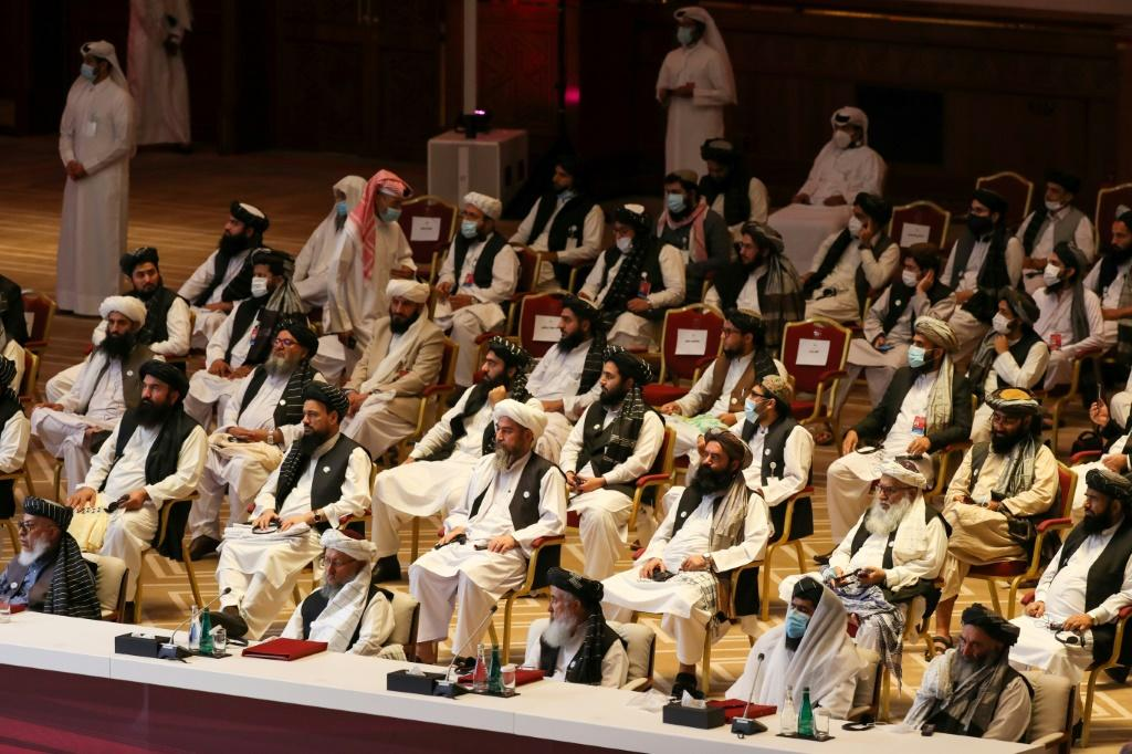 Members of the Taliban delegation at the opening of the negotiations, which are expected to be arduous and messy