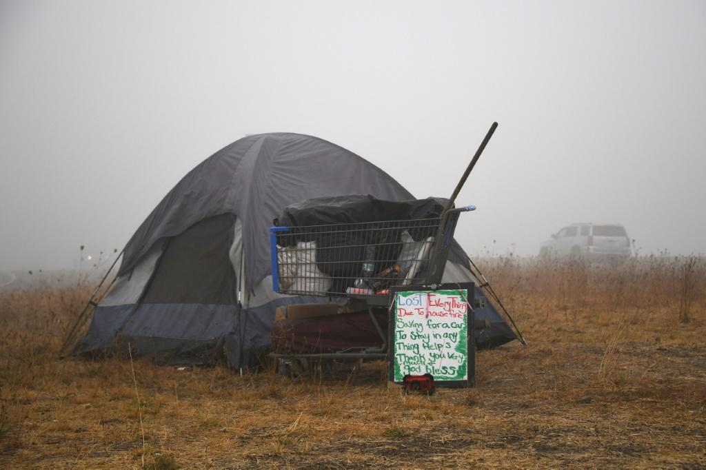 "A sign in front of a tent along the highway near Salem, Oregon on September 13, 2020 reads ""Lost Everything Due To House Fire"