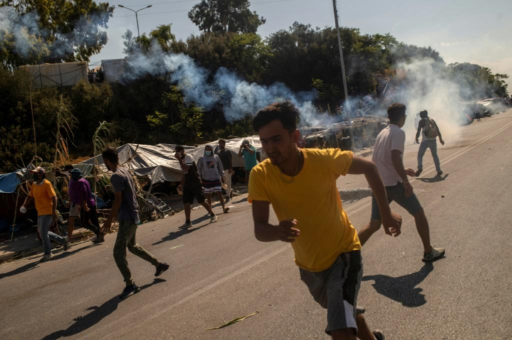 Police responded with tear gas after protesters threw stones