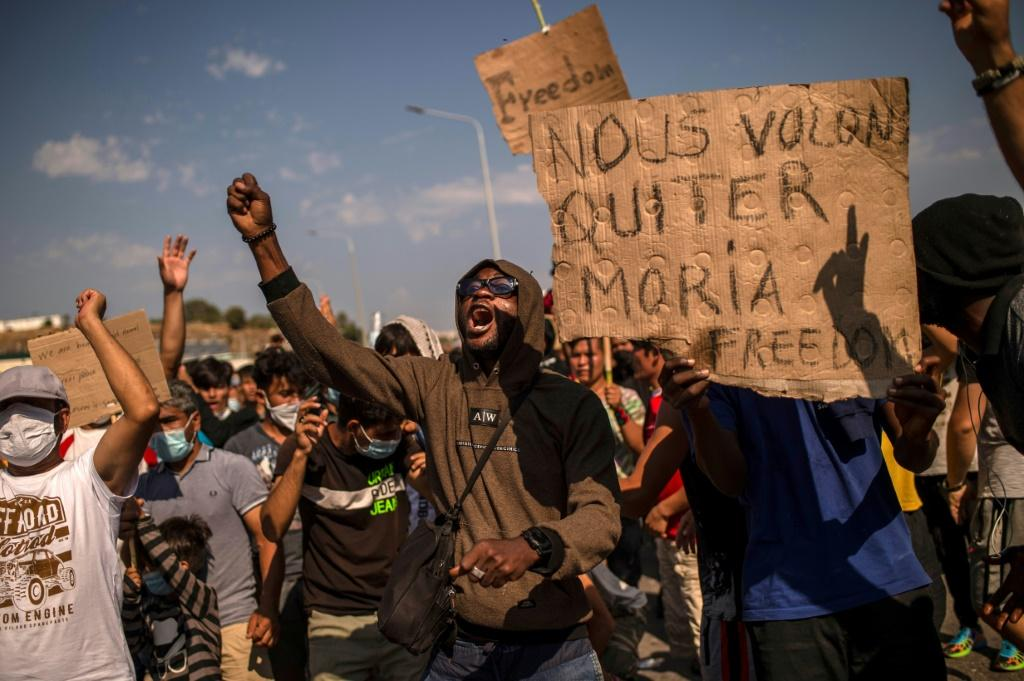 Protests by the migrants erupted on Lesbos on Saturday