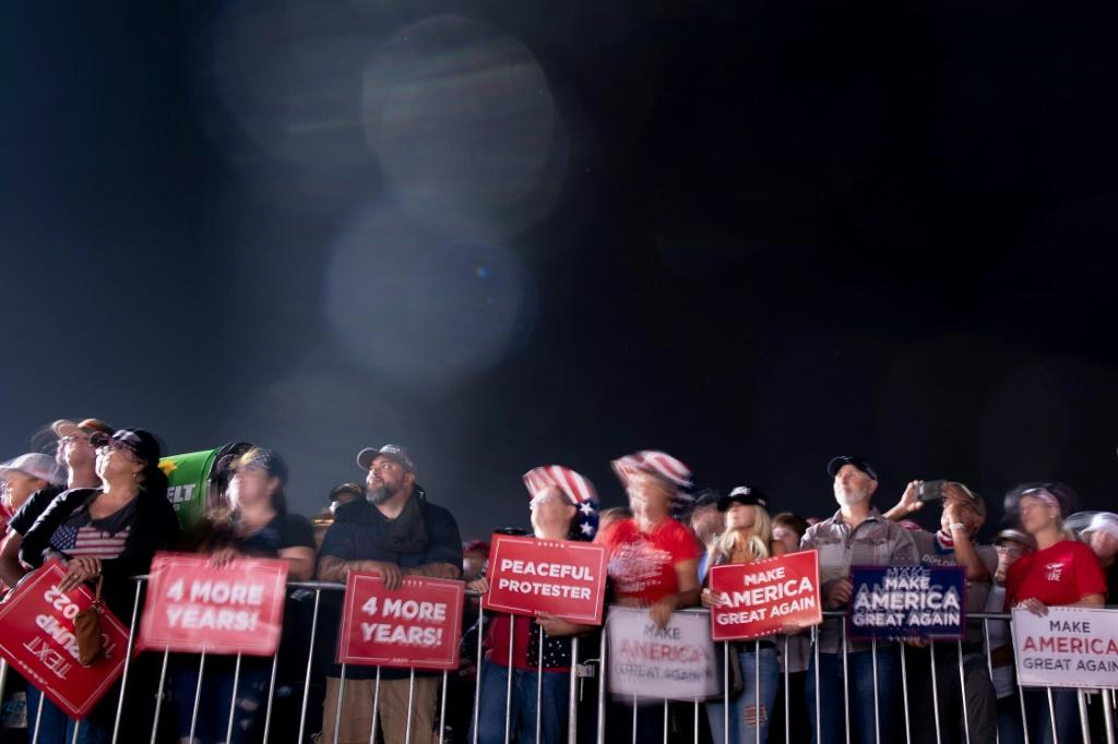 Supporters listen to US President Donald Trump speak during a campaign rally at the Minden-Tahoe airport in Minden, Nevada on September 12, 2020