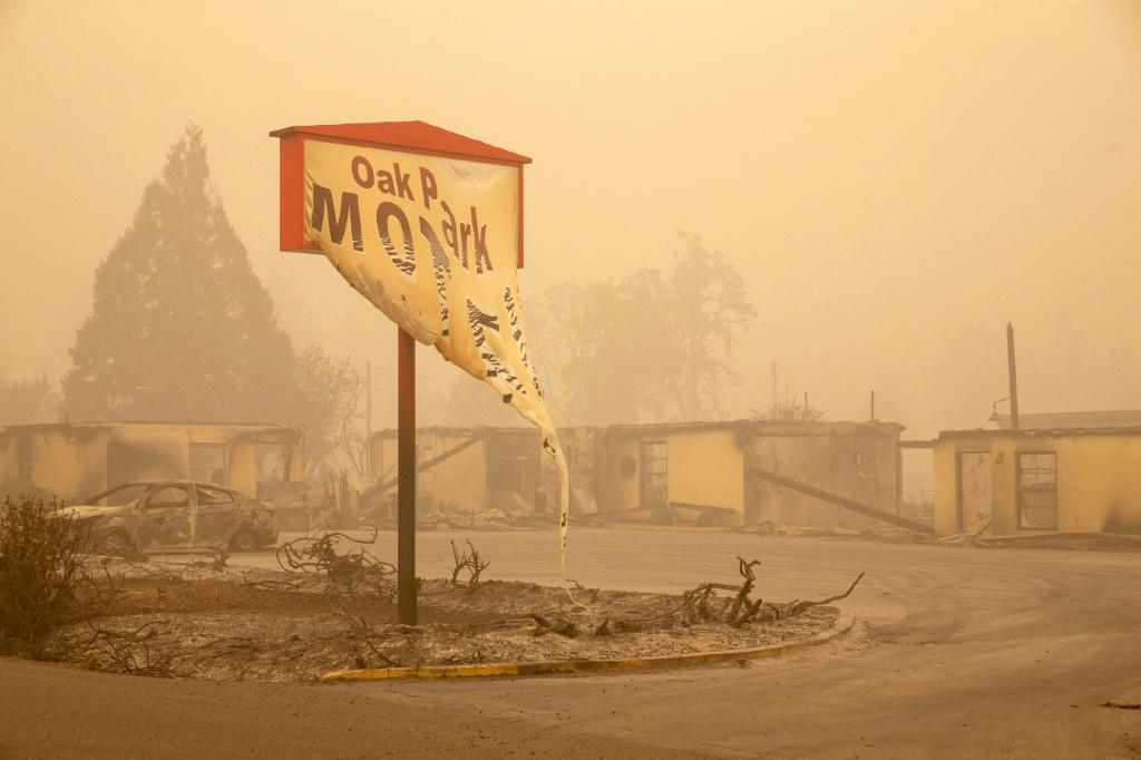 The Oak Park Motel's melted sign was destroyed in the Beachie Creek Fire in Gates, Oregon