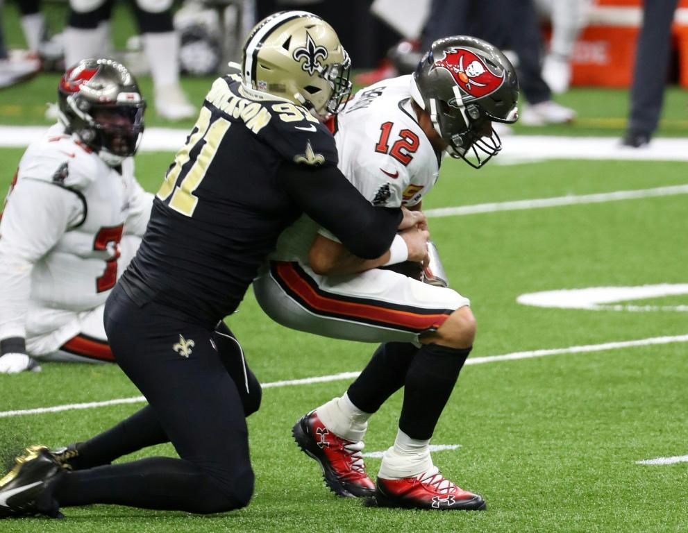 Tom Brady is sacked during a losing debut for the Tampa Bay Buccaneers against the New Orleans Saints