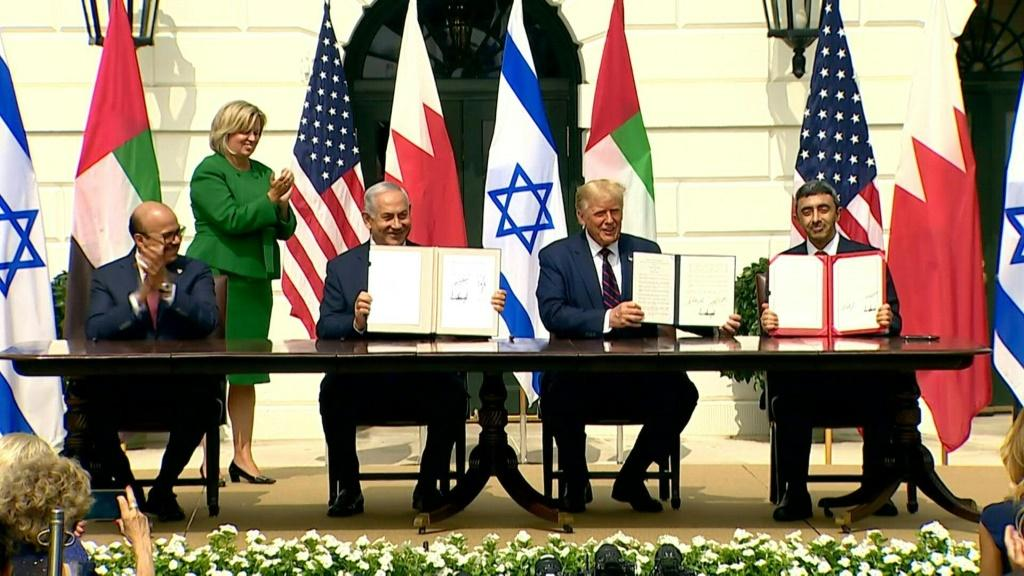 IMAGES Israel's Prime Minister Benjamin Netanyahu signs the Abraham Accords along with the Foreign Ministers of the UAE and Bahrain in a deal to normalize relations brokered by US President Donald Trump.