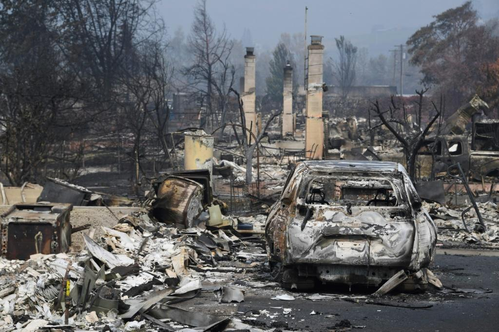A burned truck is seen among the rubble of homes destroyed by the Almeda Fire in Talent, Oregon