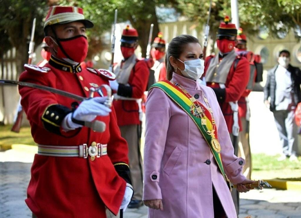 Handout photo released by the Bolivian Presidency of Bolivian interim President Jeanine Anez (R) taking part in a celebration for the 195th anniversary of the creation of the Bolivian Armed Forces in La Paz on August 7, 2020