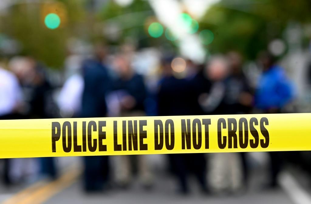 Police tape secures a crime scene outside a club after a shooting in Brooklyn on October 12, 2019. At least four people died and three were wounded in a shooting at a social club in New York eary Saturday, police said. No one has been arrested over the s