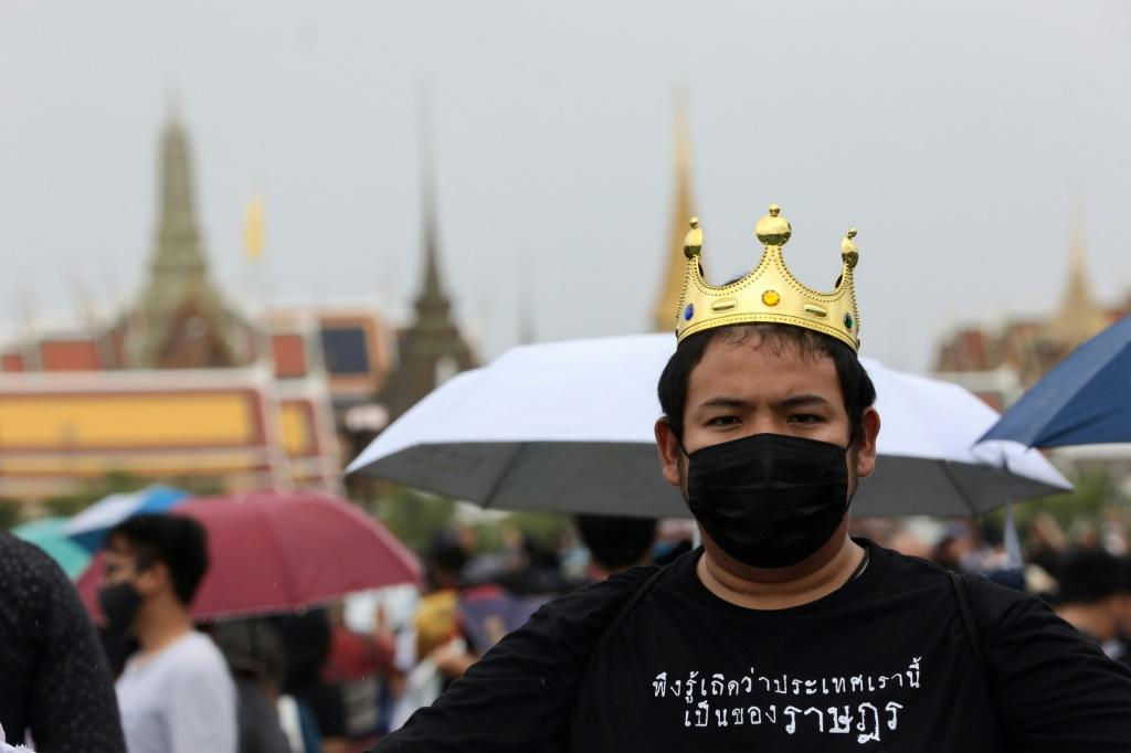 A democratic demonstrator carries a fake crown and a shirt that reads & # 39; Please understand that this country belongs to the people & # 39; during the anti-government meeting in Bangkok