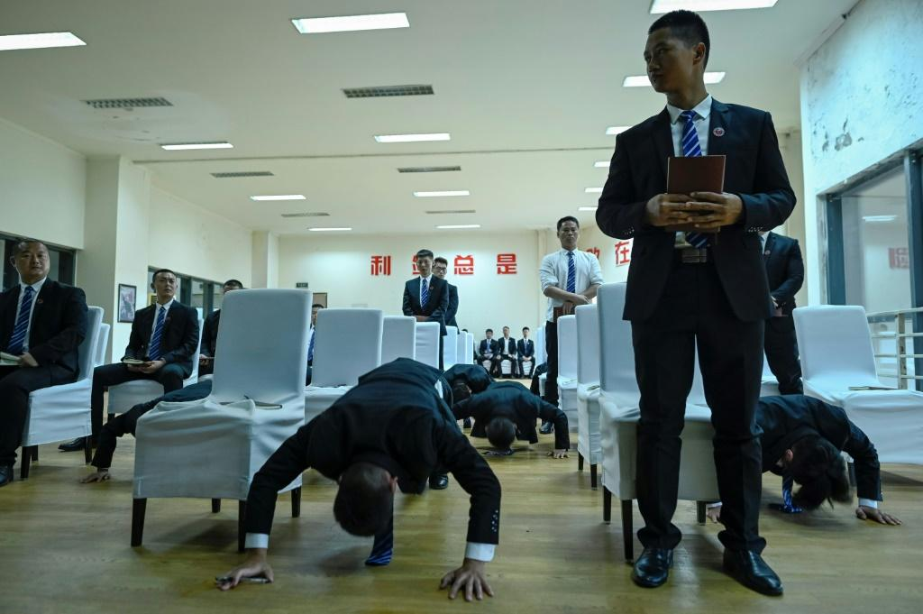 Bodyguard trainees do push-ups as punishment after they lost a debate during class