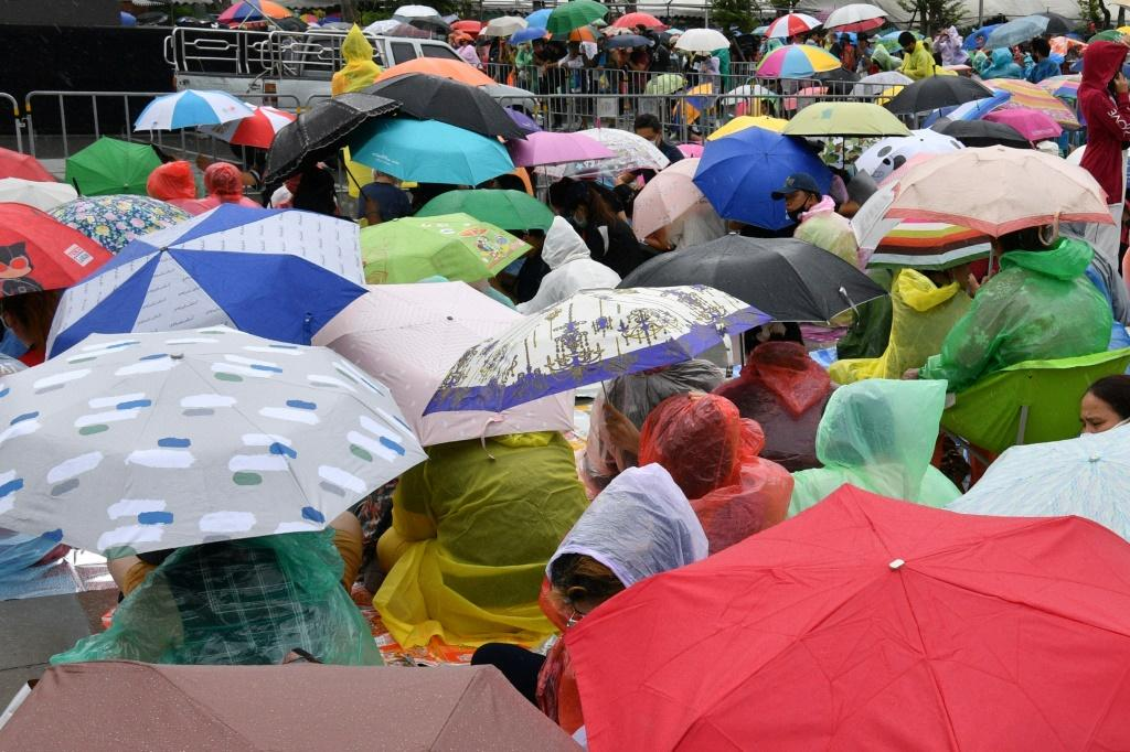 Demonstrators rallying in Bangkok's historic Sanam Luang field on September 19, 2020 braved near-constant rainfall under a sea of umbrellas