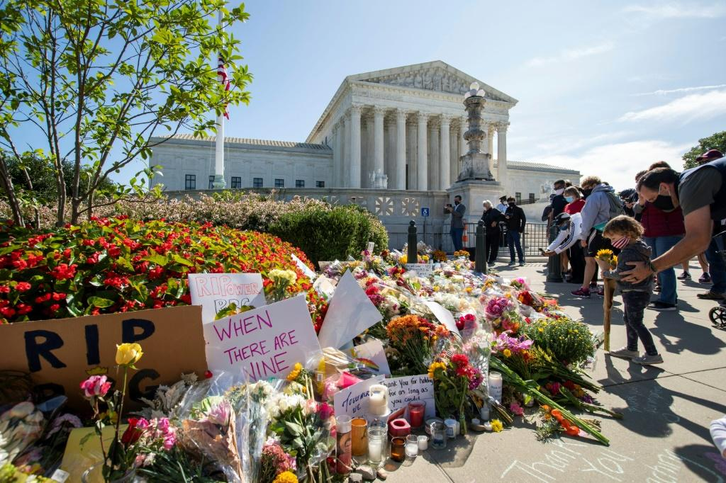 People place flowers outside of the US Supreme Court in Washington in memory of Justice Ruth Bader Ginsburg