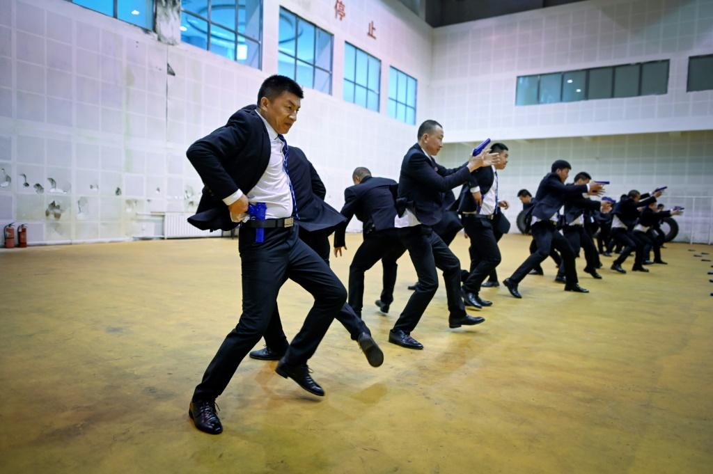 Students in matching black business suits toil from dawn until midnight at the bodyguard school in the eastern Chinese city of Tianjin
