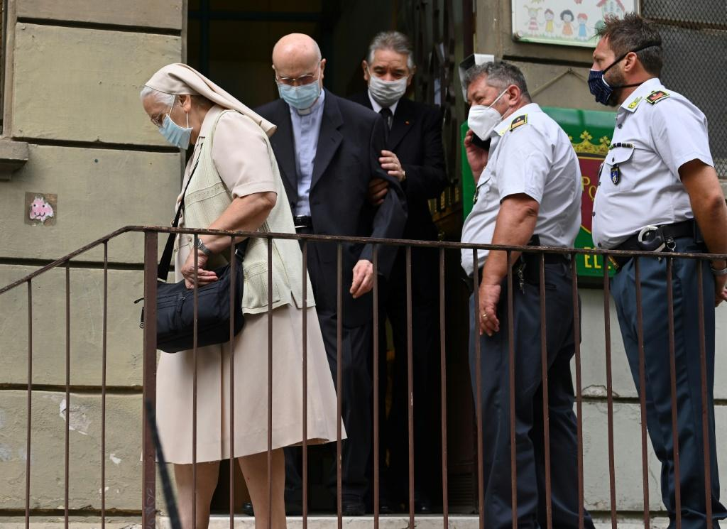 A nun leaves after casting her vote in Rome