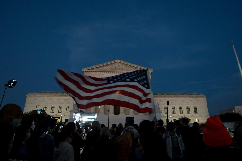 An American flag outside the Supreme Court in Washington while crowds gathered to pay tribute to late justice Ruth Bader Ginsburg