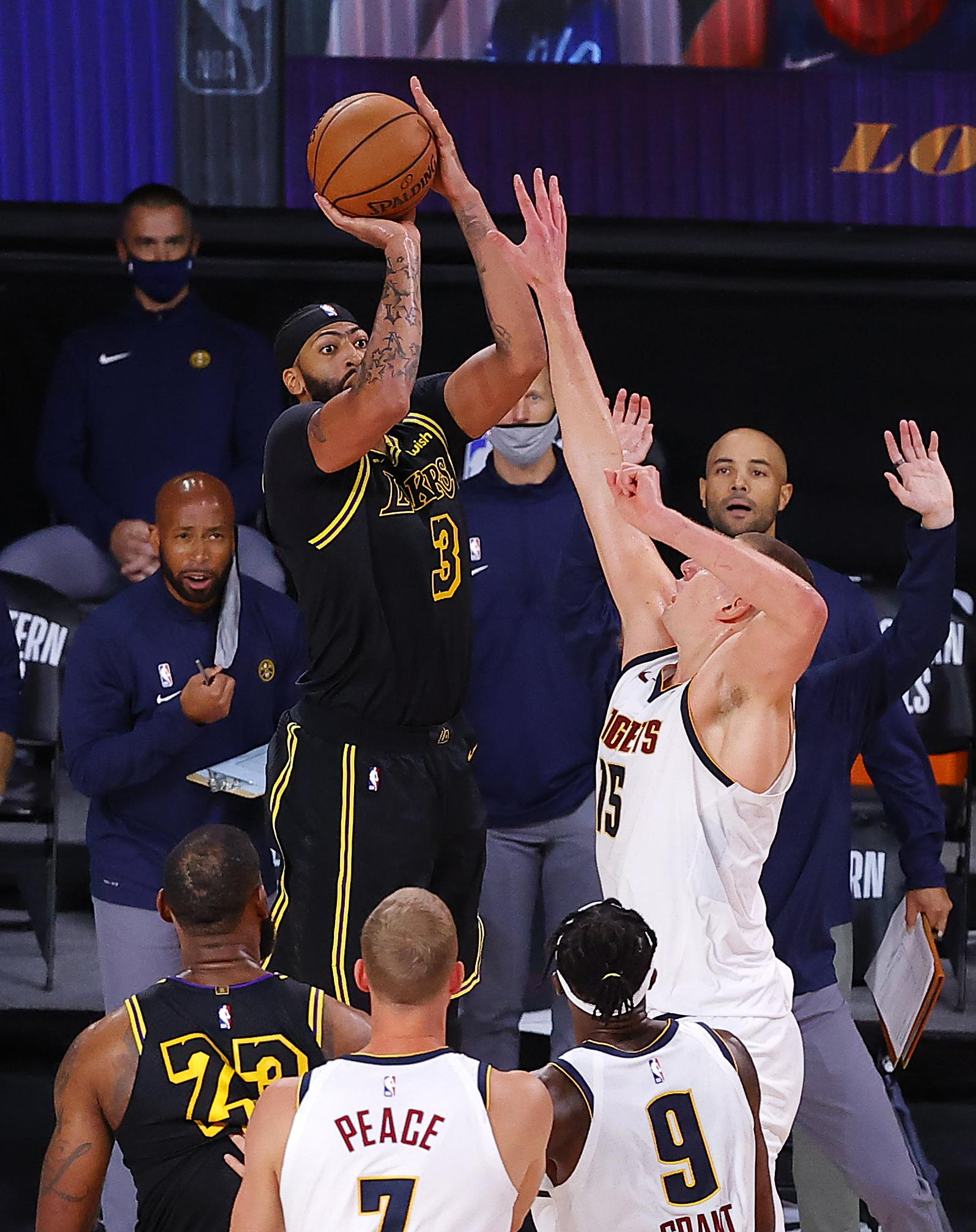 Anthony Davis #3 of the Los Angeles Lakers shoots a three point basket to win the game over Denver Nuggets in Game Two of the Western Conference Finals during the 2020 NBA Playoffs