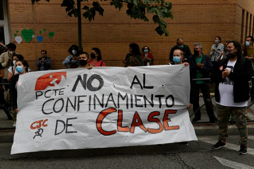 "Protesters in Madrid's Carabanchel district demand ""No to a class-based lockdown"