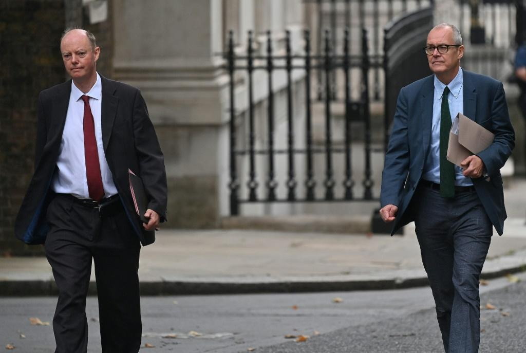 Britain's Chief Medical Officer for England Chris Whitty (L) and Chief Scientific Adviser Patrick Vallance issued a public warning about coronavirus as cases surge