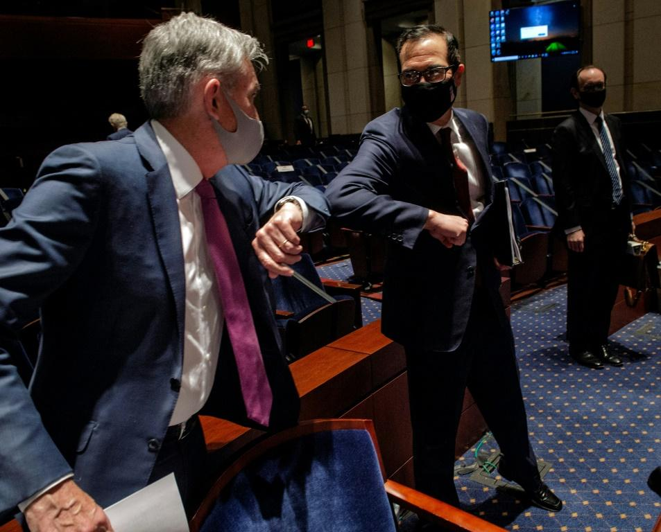 Fed Chair Jerome Powell, left, and Treasury Secretary Stephen Mnuchin, right, pictured in June 2020, are set to appear before the House Financial Services Committee