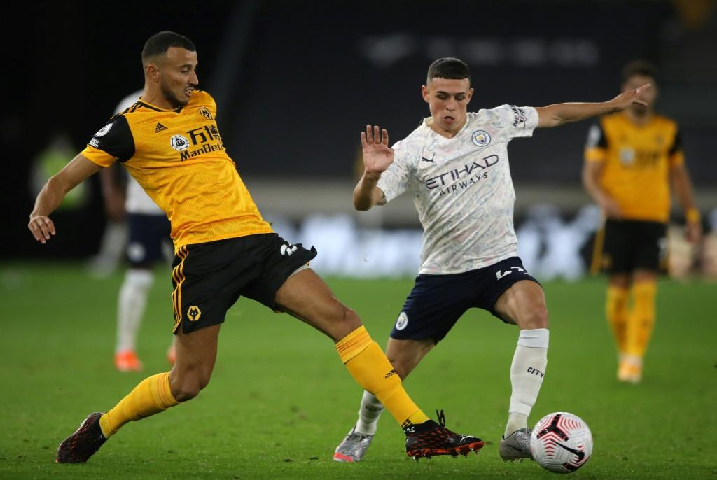 Manchester City midfielder Phil Foden (R) scored in his side's win at Wolves
