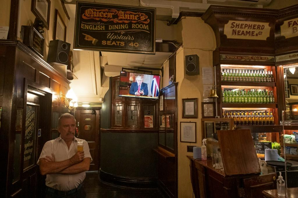 Britain's Prime Minister Boris Johnson has ordered pubs to close early to help stem the virus spread