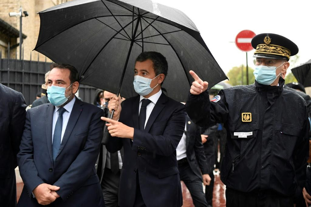 Interior Minister Gerald Darmanin (C) reminded people that France