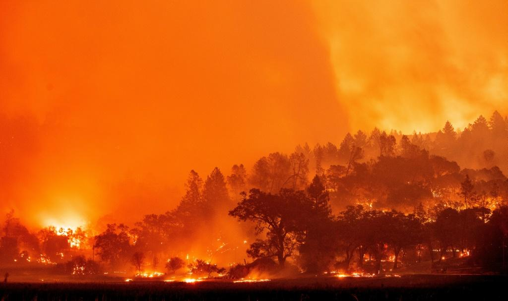 In this long exposure photograph, burning hills create a flaming landscape during the Glass fire in Napa County's St. Helena, California on September 27, 2020, described by authorities as a wildfire with a 'dangerous rate of spread.'