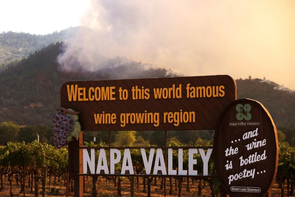 Wildfire rips through the world-famous Napa Valley, with smoke rising from the fast-moving Glass Fire on hills on September 27, 2020 in Calistoga, California