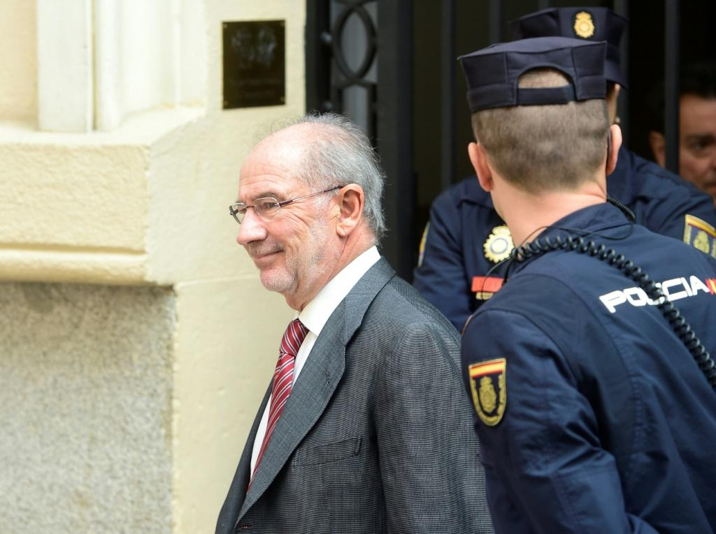 Former IMF head Rodrigo Rato, who was acquitted over fraud charges related to the 2011 listing of Bankia bank, had always maintained that the authorities were fully aware of what happened at the bank (L) smiles as he leaves his office.Former IMF chief R