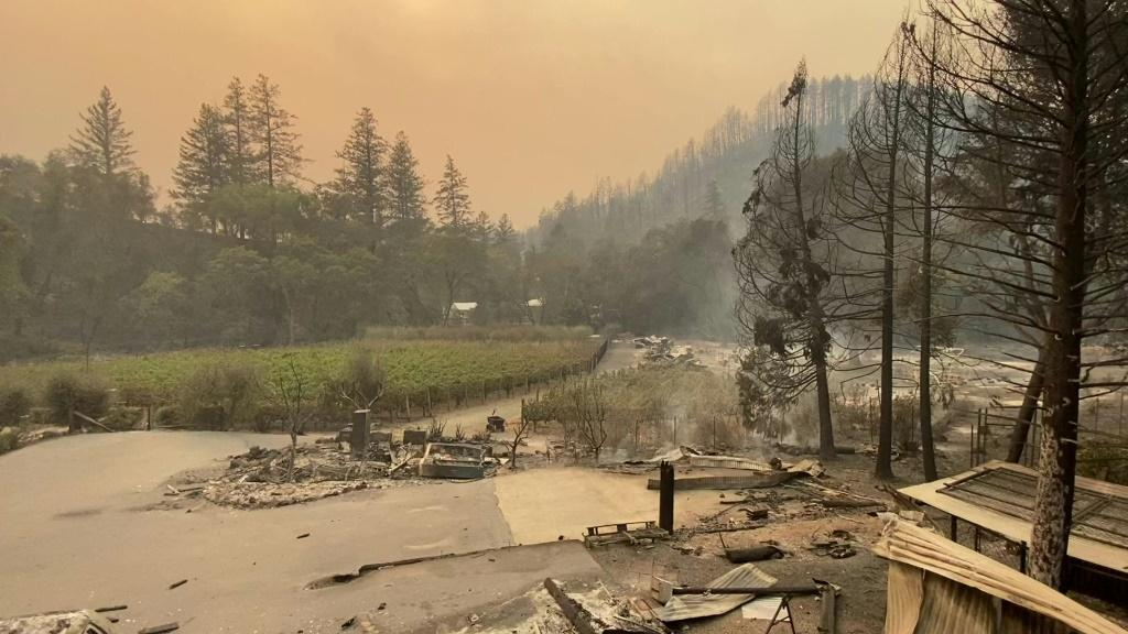 The Glass Fire spread from 1,500 acres to more than 15,000 acres overnight, leaving charred cars and a burnt down elementary school in its wake.