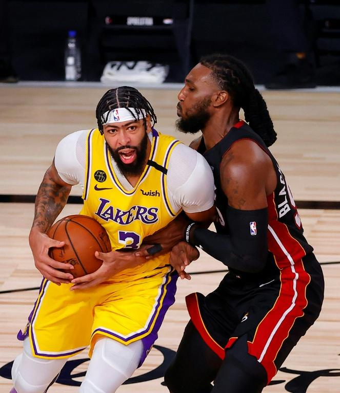 Lakers star Anthony Davis drives the ball against Jae Crowder of the Miami Heat in a dominant NBA Finals debut