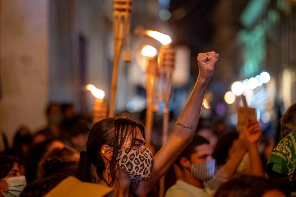 Protesters, led by the group the Feminist Collective, demand Puerto Rico Governor Wanda Vazquez declare a state of emergency in response to recent gender-based femicides, assaults and disappearance of women in San Juan, September 28, 2020