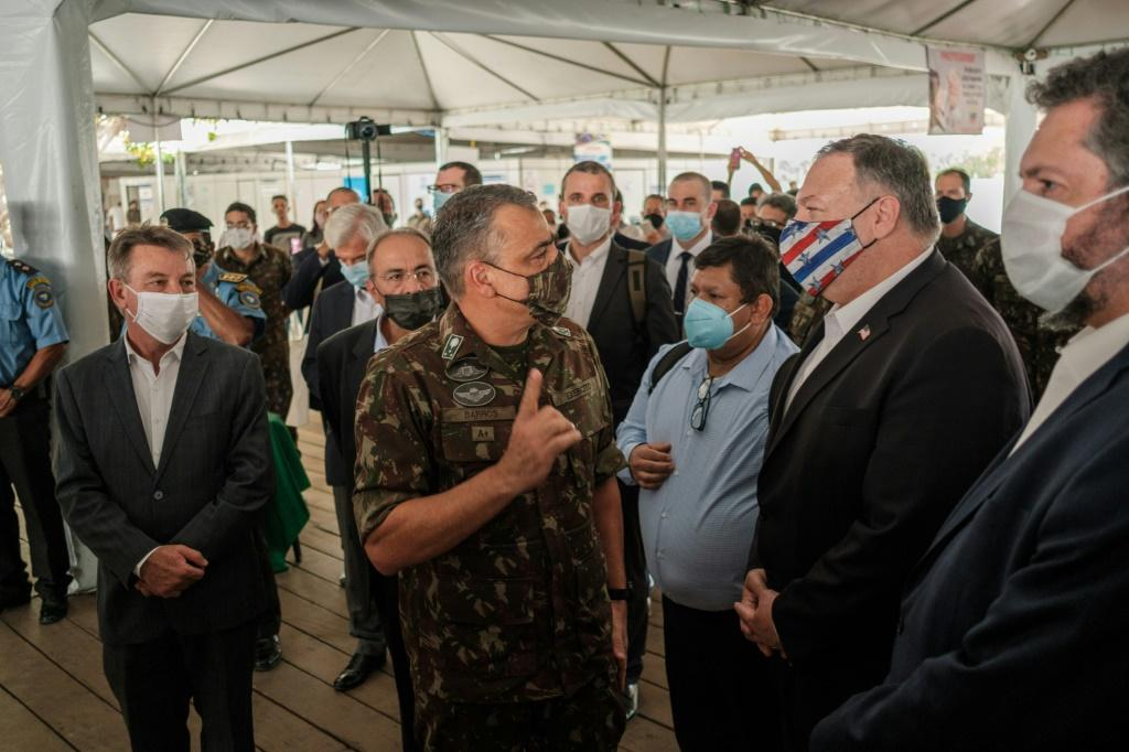 Secretary of State Mike Pompeo, wearing a mask, tours a processing center for Venezuelan migrants on a September 2020 visit to the Brazilian border town of Boa Vista