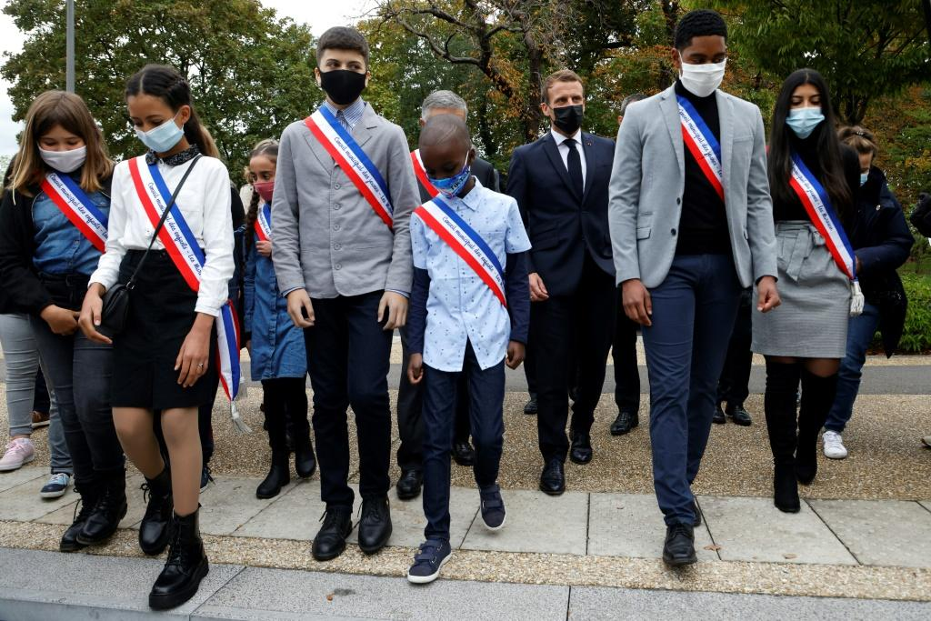 French President Emmanuel Macron, third from right, met with students in Les Mureaux on Friday before laying out his plans for fighting radical Islam.