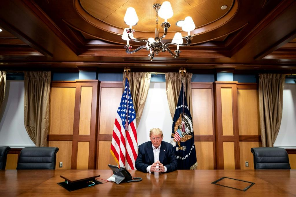 His Covid-19 diagnosis has left President Donald Trump (pictured in his conference room at Walter Reed Medical Center) sidelined from campaiging just a month before the November 3 election