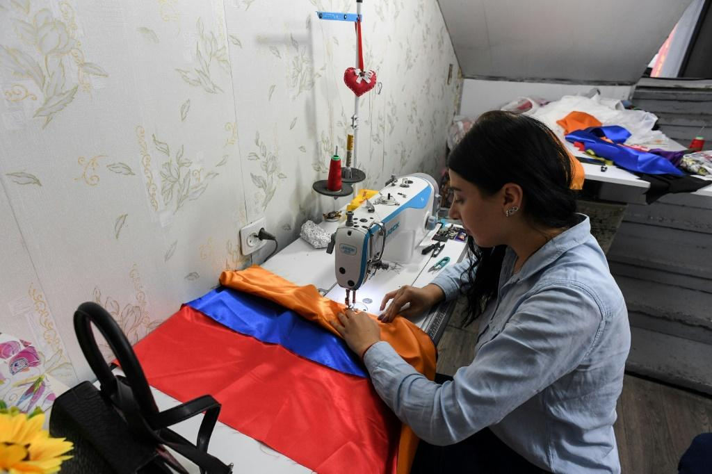 Workshops across the city are sewing more flags