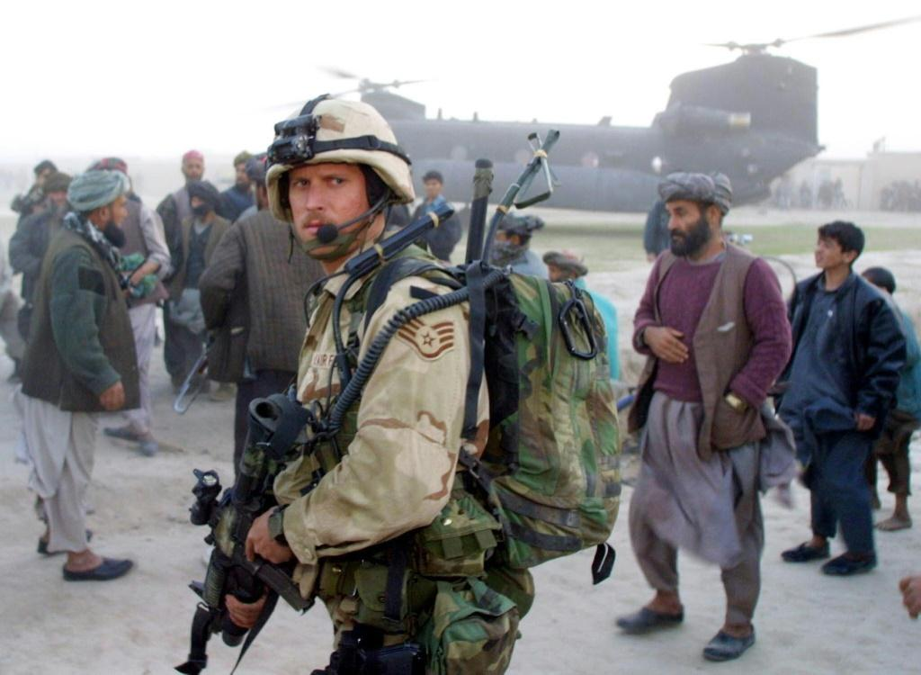 A US Air Force Special Operations soldier stands guard near a Chinook in Kwaja Bahuddine on November 15, 2001. Nearly two decades on, many Afghans fear the return of the Taliban