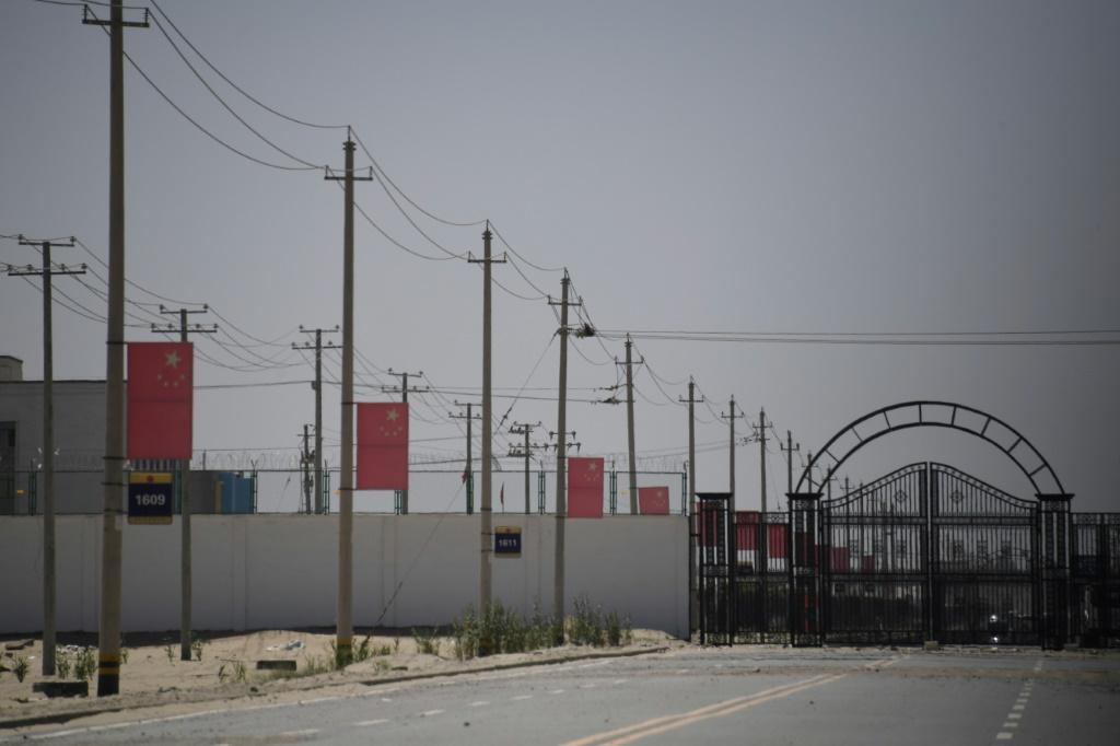 Chinese flags are seen along a road leading to a facility believed to be a re-education camp where mostly Muslim ethnic minorities are detained, on the outskirts of Hotan in the country's Xinjiang region in May 2019