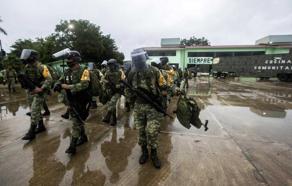 Mexican troops prepare to deploy in preparation for the arrival of Hurricane Delta