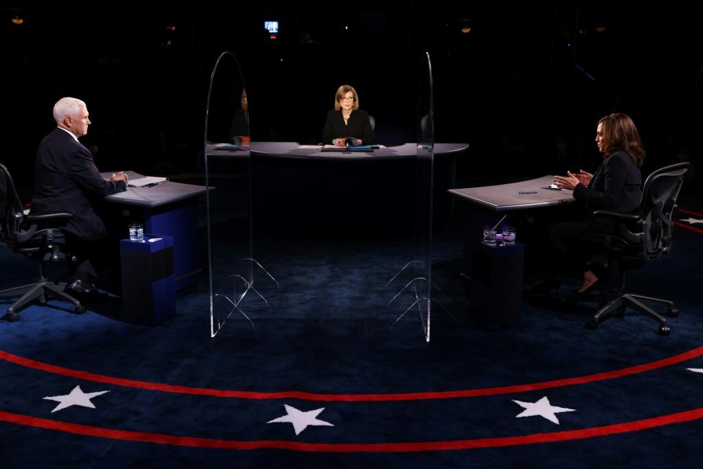 Democratic vice presidential nominee Senator Kamala Harris and US Vice President Mike Pence participate in the vice presidential debate in Salt Lake City, Utah
