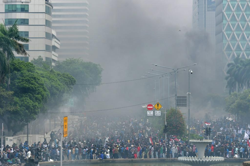 Smoke rises from fires set by activists during protests in Jakarta